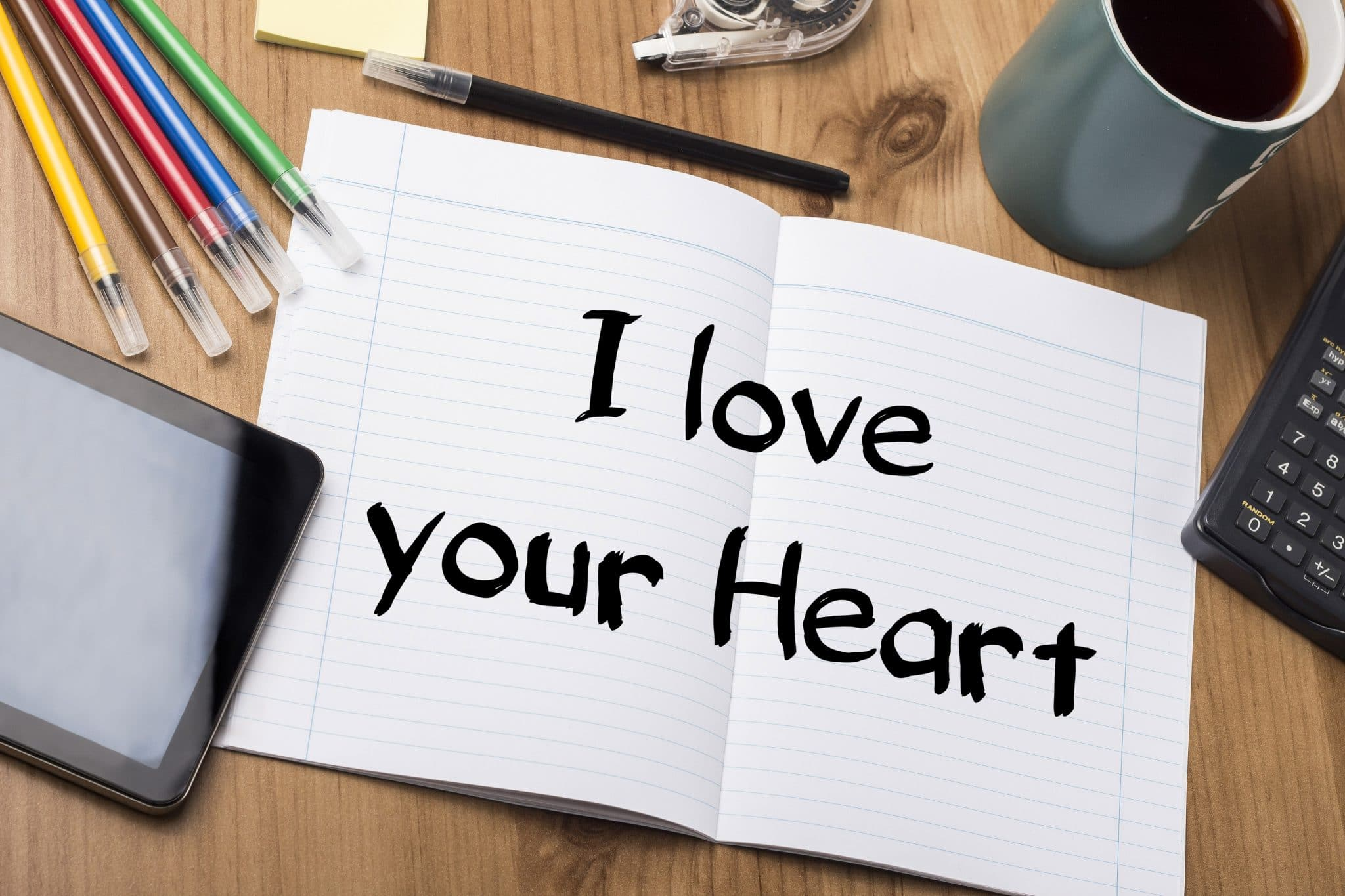 """I love your heart"" note on pad of paper"